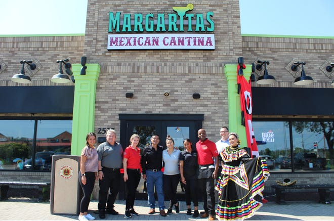 Margarita's Mexican Cantina, 2525 W. Ridge Road, Greece, opens with a ribbon-cutting ceremony attended by owner Joe Castaneda, receiver of taxes Andrew Conlon and Supervisor Bill Reilich. Castaneda's daughter, Brenda, will manage this location with general managers Jose Avalos and Marissa Salazar.