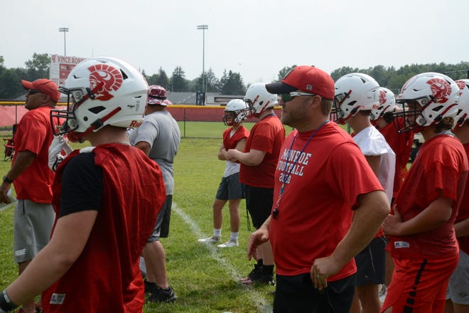 Head coach Nick Notario watches the opening day of practice for Monroe Monday.