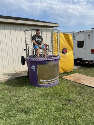 Undersheriff Jeff Pauli was among 16 persons who volunteered to be in a dunking booth used as a fundraiser at the Monroe County Fair last week to benefit either Monroe County Animal Control or the Monroe County Substance Abuse Coalition.