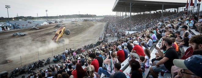 A capacity audience cheers on the Monster Trucks last Friday at the Monroe County Fair.