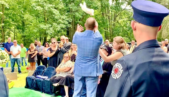 A dove is released during the graveside ceremony in honor of Lt. Frank Brown.