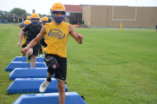Senior Ryan Gennoe leads his teammates through a drill on the opening day of practice for Jefferson Monday.