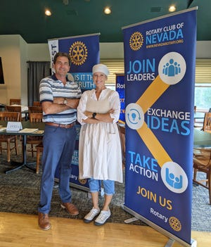 Emmi Miller, right, president of the Rotary Club of Nevada, portrays a woman from the 1930s and member Dick Pringnitz portrays the 1930s era club secretary.