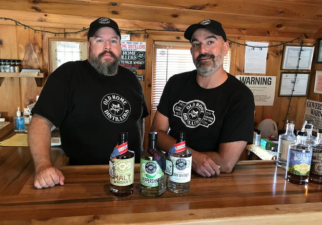 Adam, left, and Aaron Carvell pose with their recent award-winning products Aug. 10 at Old Home Distillers in Lebanon. They are open noon to 4 p.m. Thursdays and noon to 5 p.m. Fridays and Saturdays for tours and tastings.