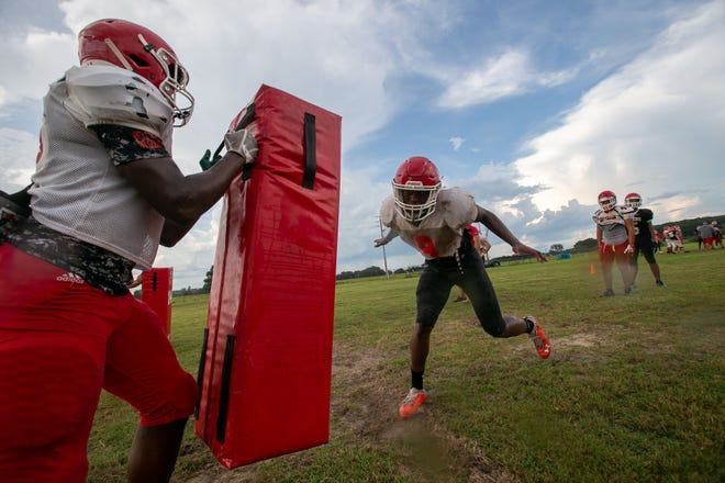 Players work on drills as the Dunnellon Tigers prepare for the Kickoff Classic later this month.