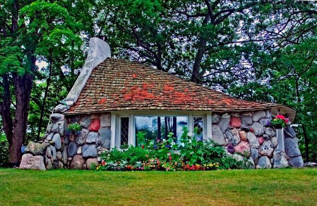 """One of Charlevoix's Earl Young """"mushroom"""" homes, located at 302 Park Ave and nicknamed the """"Half House"""" for its size and shape. In his most recent book, historian David Miles describes the home as being one of the reasons Earl's residential creations have been called Hansel and Gretel houses, gnome homes, troll houses and Tolkien homes."""