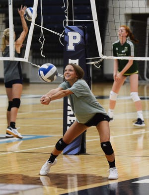 Petoskey athletes go through receiving drills during the first fall volleyball tryout on Monday in the Petoskey High School gym.