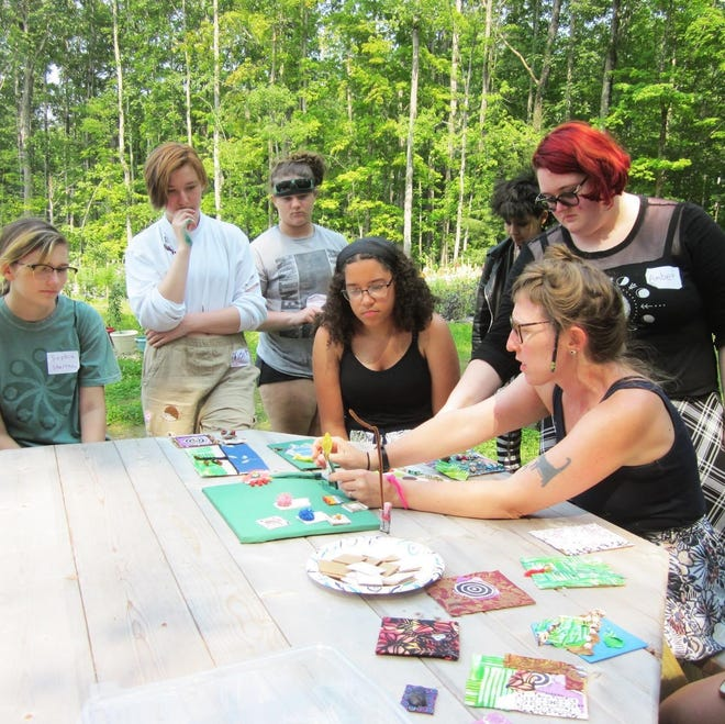 Arts In Reacg teens working with visual teaching artist Meagan Samson at Bedrock Garden in Lee, NH.