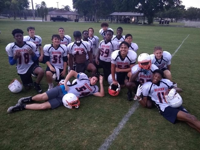 Berean Christian players strike a pose after competing in a 7-on-7 tournament this summer.