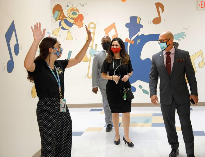 Palm Beach County School Board Member Alexandria Ayala, left, and Ed Tierney, Deputy Superintendent/Chief of Schools, right, are shown around Belvedere Elementary School in West Palm Beach on opening day of school.