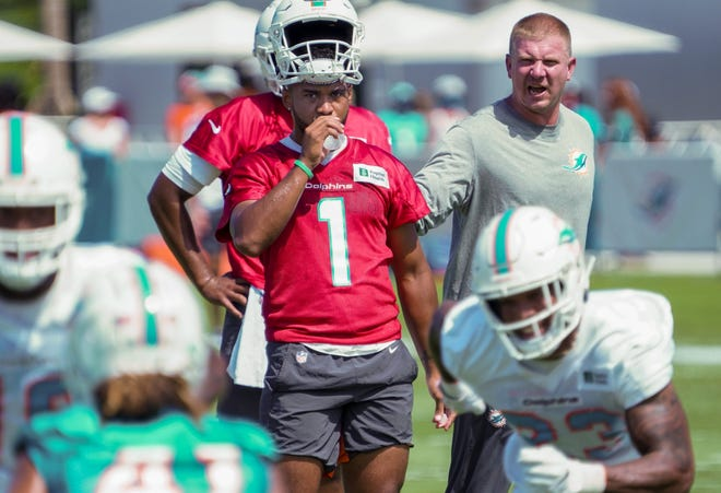 Quarterback Tua Tagovailoa (1) takes a water break at Miami Dolphins training camp, July 31, 2021.