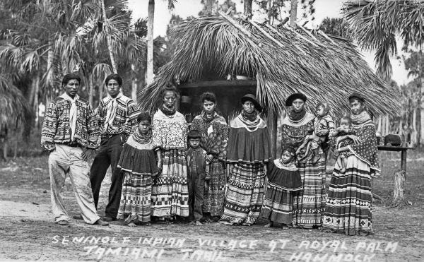Life as the Seminole Tribe knew it in the Everglades in the late 1800s and early 1900s came to an end when the Tamiami Trail pushed through some of their settlements. Tamiami Trail was constructed from 1915 to 1928. Pictured is a Seminole village at Royal Palm Hammock on the Tamiami Trail in 1920.