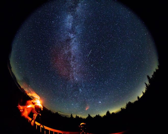 In this 30 second exposure taken with a circular fish-eye lens, a meteor streaks across the sky during the annual Perseid meteor shower on Friday, Aug. 12, 2016 in Spruce Knob, West Virginia. Photo Credit: (NASA/Bill Ingalls)