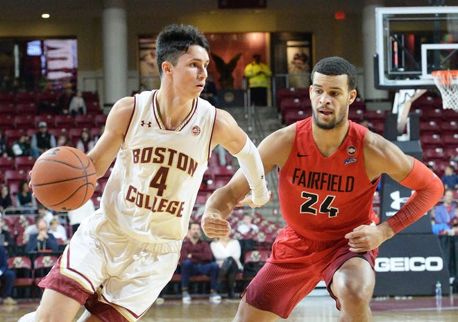 Boston College's Chris Herren Jr. drives around a Fairfield player during a game in 2018. Herren transfered from BC to the University of San Diego to play basketball but apparently has now moved on to University of Alabama to play football.