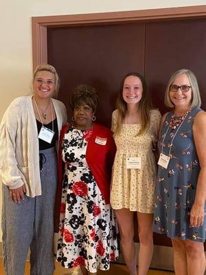 From left are scholarship winner Jessica Nuber of Streetsboro High School, new member/retiree Janice Tabbs from Maplewood Career Center, scholarship winner Abigail Pincoe of Streetsboro High School and new member/retiree Lisa DeMarco of Tallmadge schools.