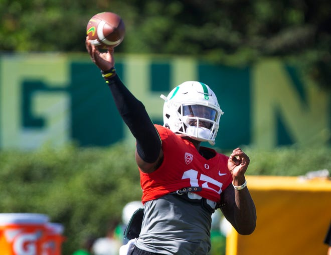 Oregon quarterback Anthony Brown throws down field during a workout with the Ducks during Fall Camp.