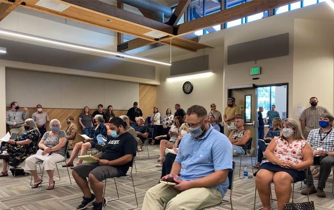 Springfield School Board's Aug. 9 meeting had dozens of people show up to hear the latest fall plans and voice opinions on the state mask mandate. More people were standing along the walls.