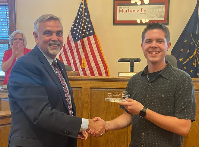 Martinsville Mayor Kenny Costin (left) presents Isaac Merida with a key to the city of Martinsville during Monday night's city council meeting.