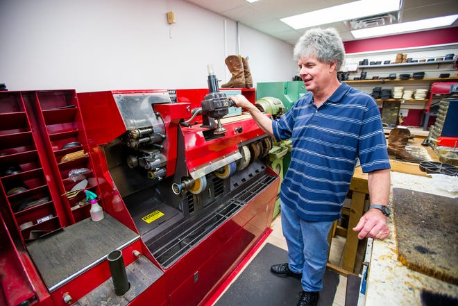 Owner Brien Hall talks about his business Tuesday at Violi Shoes in Mishawaka.
