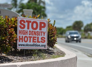 Signs posted by residents opposed to high density hotels can be seen in numerous locations around Siesta Key.