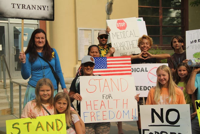 Protesters against the state mandate requiring heathcare workers to get the COVID-19 vaccine stand in front of the old courthouse in Yreka Tuesday, Aug. 10, 2021, before the Siskiyou County Board of Supervisors meeting.