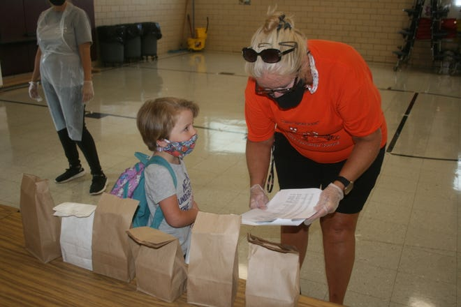 Kewanee school students will be asked to mask, just as they did in this back-to-school photo taken at Belle Alexander last year. Last week the governor overrode Dist. 229's new policy that would have allowed vaccinated students and teachers to go mask-less.