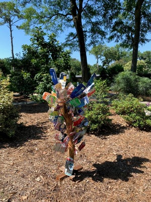 The flower tree is a colorful reminder of the importance of nature.