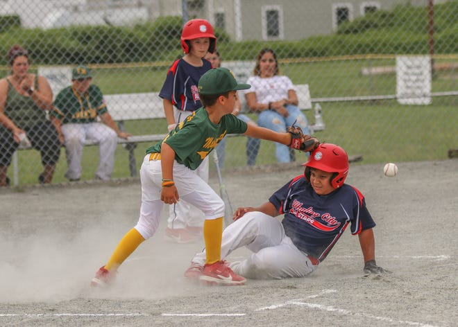 Stephen Charves of Maplewood reaches for the ball as Jose Martinez Jr. of Whaling City slides safely in at home during the John Steele All Star Tournament at DYAA.