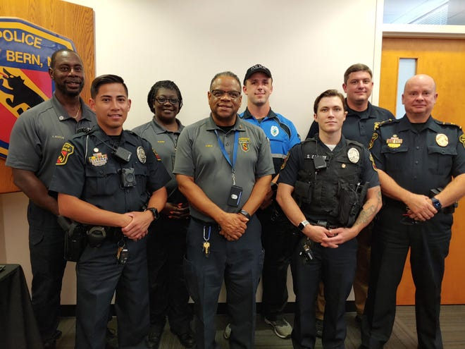 Some military veterans with the New Bern Police Department's pose for a photo with Chief Patrick Gallagher, right.