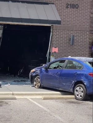A still shot from a video Jonathan Dump posted to his 614,000 TikTok followers shows a Kia sedan being pulled from Best of Ink tattoo parlor on Skibo Road on Sunday. Dump said the driver's brakes gave out, sending the sedan careening into the front of the shop where customers and workers were. No injuries were reported.