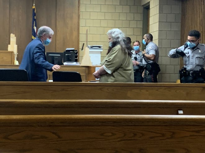 Deborah Riddle O'Conner enters the courtroom Tuesday as her attorney Bernard Condlin pulls out her chair for her. She pleaded guilty to second-degree murder in the death of her infant son, Baby Michael, and she was sentenced to at least 12 years in prison.