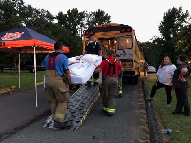 Fire fighters and medics from local departments helped to load patients from Coosa Valley Health and Rehab onto the Gadsden/Etowah County Emergency Management Agency's 'ambu-bus' after a fire at the facility Monday afternoon.