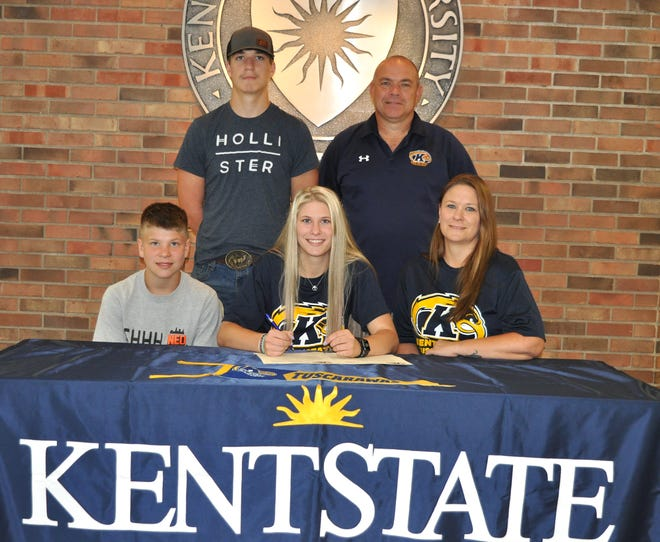 Signing a letter of intent is Kaley Steigerwald (center) seated between her brother Tyler Steigerwald and her mother Rebecca Givens. In the back row are Kaley's brother Michael Steigerwald and Kent State Tuscarawas Head Softball Coach Chuck Peach.