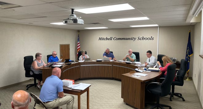 Members of the Mitchell School Board gather with VPS Architecture Vice President George Link prior to their Monday evening meeting.