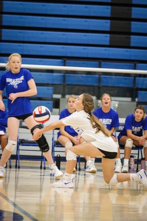 Sophomore Kaelyn Miller digs a ball in her first varsity action.