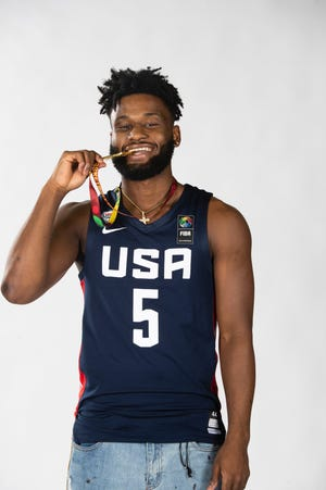 Team USA's Mike Miles of Lancaster kisses his gold medal after lelping lead the team to the U19 Olympics championship in Latvia last month.