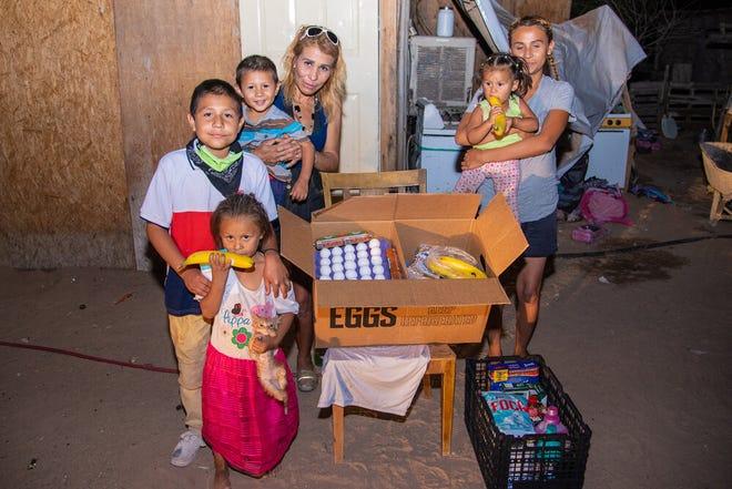 A family in San Luis Rio Colorado with their latest grocery delivery from Misión de Caridad. [Courtesy Photo]