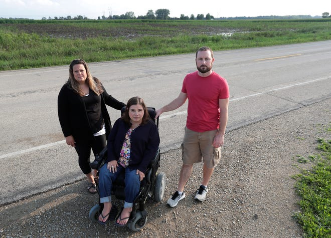 Jessica Wogernese, from left, Christy Coenen and Josh Fetting are concerned about New Ag Services potentially building a fertilizer blending plant near their homes. The three are pictured in front of Coenen's home on County S in the Town of Center. The field behind the group is the proposed location of the plant.