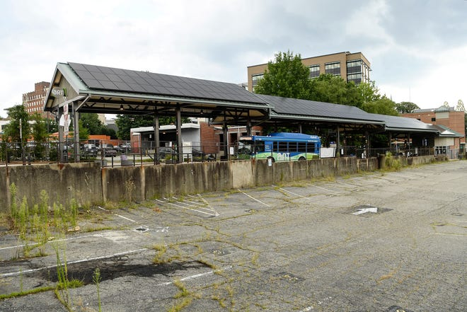 """The city could vote to purchase a .9-acre """"Talbert Lot,"""" directly south of the transit center and use a portion of it for affordable housing."""