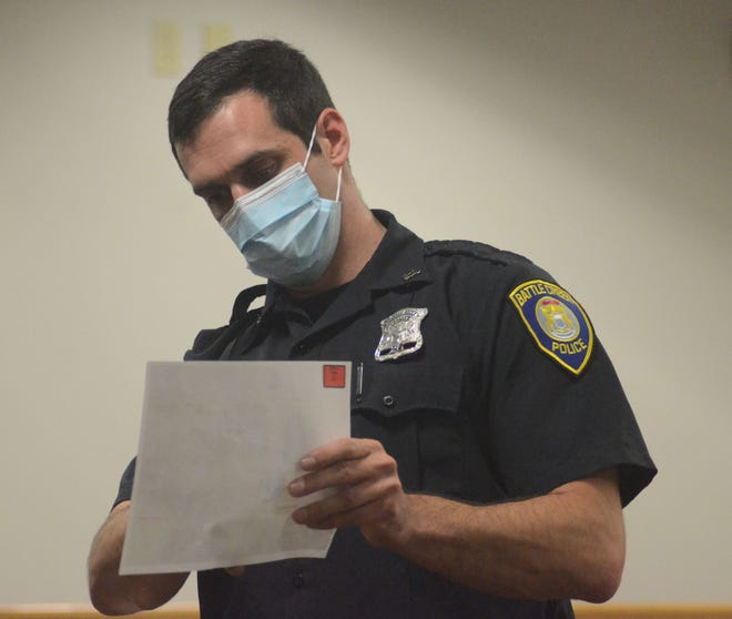 Battle Creek Police Officer Jeff Johnson uses a photograph to tell the jury what happened the night he was shot.