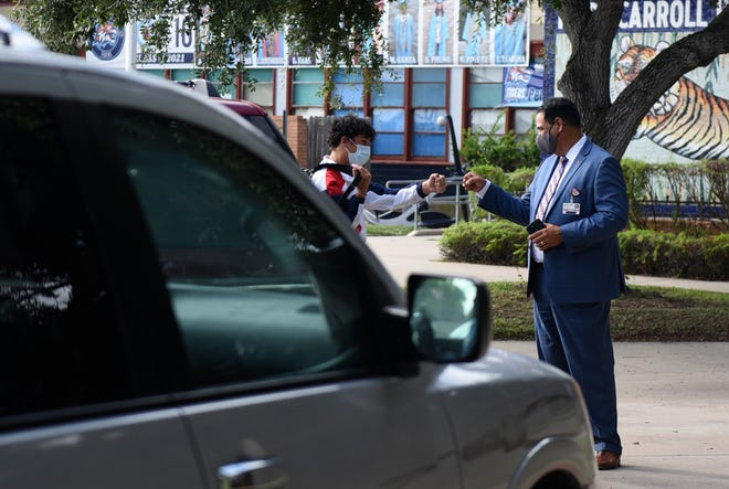 Corpus Christi ISD Superintendent Roland Hernandez greets Carroll High School students on their first day, Tuesday, Aug. 10, 2021. Masks are highly encouraged on all campuses.