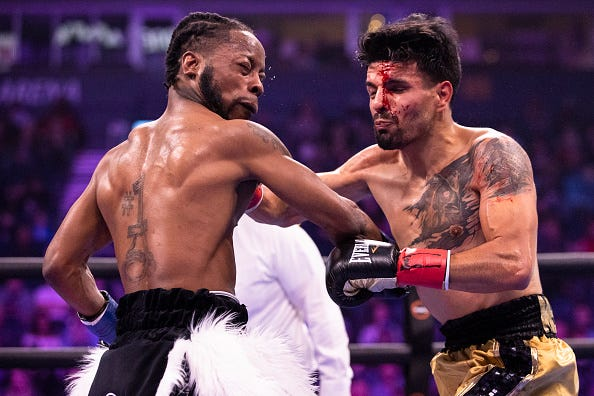 Rau'shee Warren (left) trades blows with Gilberto Mendoza during their bantamweight bout at Bridgestone Arena on February 15, 2020 in Nashville, Tennessee.