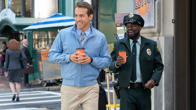"""Ryan Reynolds and Lil Rel Howery in """"Free Guy."""""""