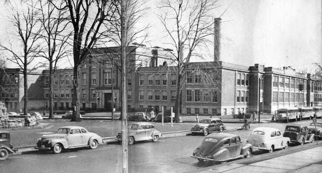This nostalgic view of Ross High School, looking SE from the steps of the courthouse, appeared in the 1948 school yearbook. Many mid-century automobiles are seen here along Park Avenue, as well as some buses lined up beside the school at the right. At the far left is the stone foundation in the park that originally was the base of the Standpipe.