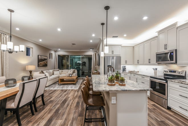 The Largo is the more popular of the two floor plans. Even though it is a bit smaller in size, buyers like having the den/flex room in the front of the house and room for a dining room table in the great room.