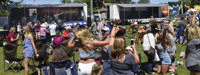 Music fans dance the day away during a live performance at a past Shanty Days in Algoma. The 34th annual festival on the Lake Michigan shoreline takes place Aug. 13 to 15.