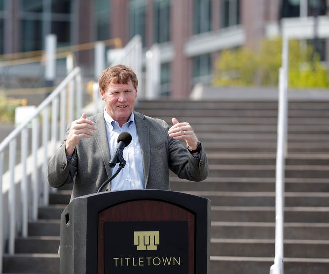"""Green Bay Packers president and CEO Mark Murphy speaks at a ribbon-cutting ceremony for Titletown Square on Aug. 10, 2021, in Ashwaubenon, Wis. The team has opposed a California company's request to trademark """"Twin Title Town"""" over concerns it would infringe on the team's own Titletown-related trademarks."""
