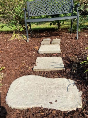 This bench and stepping stones were covered in overgrowth before a group from Soulquest Church cleared the area and cleaned the stones and bench and made it a more inviting area for people to sit and discuss or think to themselves.