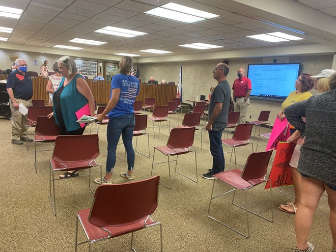 Protestors at the the Aug. 9, 2021 Lafayette School Corp meeting sharing their opinions on the mask mandate as they exit the adjourned meeting.