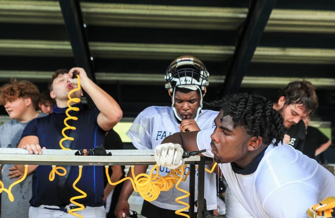 Fairdale High School football players take a water break on a hot afternoon recently. Due to the heat index that day, the team's practice was cut short. The Bulldogs' undefeated season last year was derailed by Covid-19.  August 8, 2021
